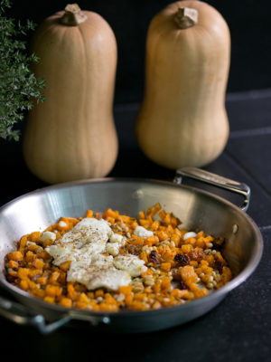 Caramelized-squash-pine-nuts-and-golden-raisins-topped-with-warm-goat-cheese