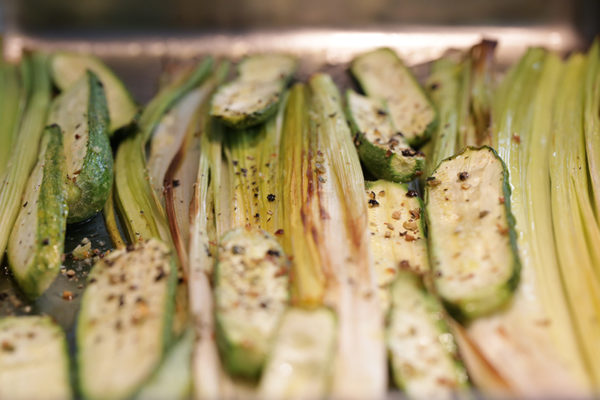 Grilled courgettes and leeks with walnuts and herbs